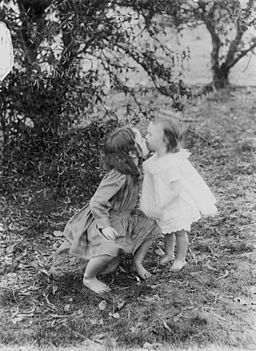 StateLibQld 1 174575 Nancy and Marie Flanagan kissing, 1911