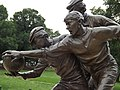 Statue of first recorded footy game MCG 01.jpg