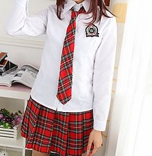 Young girls in catholic school uniforms consider