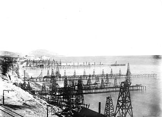 Offshore oil and gas in California - Oil wells on wharves built out over the ocean, Summerland oil field, 1902.