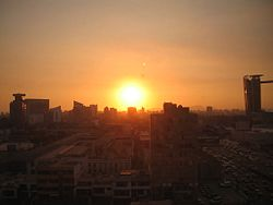 Sun over San Isidro District of Lima.jpg