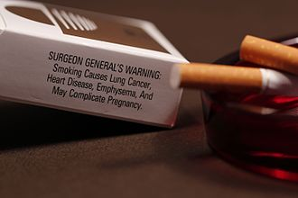 Politicization of science - A cigarette carton warns about the health risks of smoking. Public awareness was delayed by a SCAM (Scientific Certainty Argumentation Method).