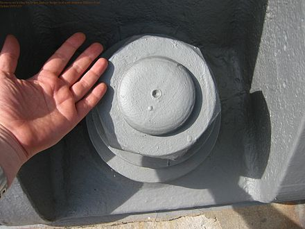 One of the nuts that hold the bridge on its abutments; this one is at the north end. SydneyHarbourBridgeNutMilsonsPoint.JPG