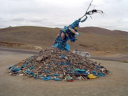 Ceremonial cairn of rocks, an ovoo, from Mongolia TallOvoo.JPG