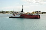 Tango II being tugged at the harbor. (4674119392).jpg