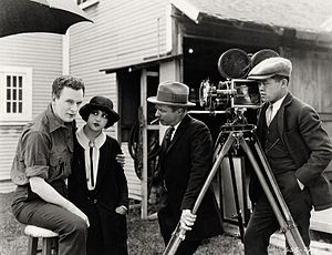 James Wong Howe - Howe (right) making a silent feature with (l-r) Thomas Meighan, Estelle Taylor and director Herbert Brenon during the filming of 1924's The Alaskan.