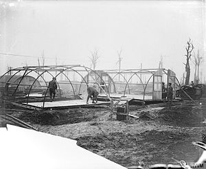 Nissen hut - British troops erecting Nissen huts; near Bazentin, November 1916