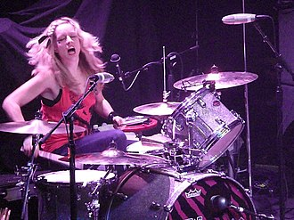 Torry Castellano - Castellano performing with The Donnas (2008).