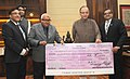 The MD, State Bank of Patiala, Shri S.A. Ramesh Rangan presenting a cheque to the Union Minister for Finance, Corporate Affairs and Information & Broadcasting, Shri Arun Jaitley.jpg