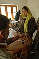 The Polling officer administering indelible ink at the finger of a female voter at a polling booth of Budgam, Srinagar in Jammu & Kashmir during the 4th Phase of General Election-2009 on May 07, 2009.jpg