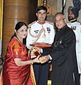 The President, Shri Pranab Mukherjee presenting the Padma Bhushan Award to Dr. (Smt.) Kanak Yatindra Rele, at an Investiture Ceremony, at Rashtrapati Bhavan, in New Delhi on April 05, 2013.jpg