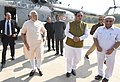 The Prime Minister, Shri Narendra Modi being welcomed, on his arrival, at Gandhinagar, in Gujarat on December 10, 2016. The Chief Minister of Gujarat, Shri Vijay Rupani is also seen.jpg