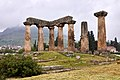 The Temple of Apollo in Corinth. In the background the Acrocorinth gradually covered in mist.jpg