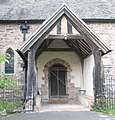 The church porch of St Milburgh, Stoke St Milborough - geograph.org.uk - 1443475.jpg