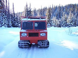 Snowcat vehicle used to manipulate snow for recreational uses