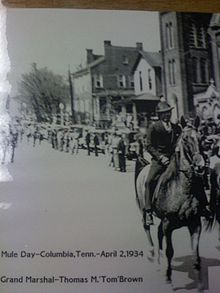 Thomas Marion Brown leading the first Mule Day Parade in 1934