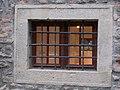 Thury Castle, SE, barred window, 2017 Várpalota.jpg