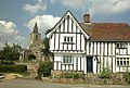 Timbered house Rattlesden, St Nicholas Church behind - geograph.org.uk - 226027.jpg