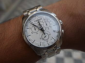Tissot - Image: Tissot Couturier watch on hand