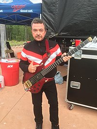 Tony Lewis photo with bass 2018.jpg