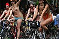 Topless woman riding a bicycle.jpg