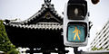 Trafic light against the background of pagoda roof in Fukuoka, Japan, East Asia.jpg