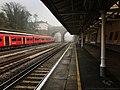 Train in a misty station (26418437549).jpg