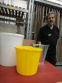 Trainee sales clerk with three buckets.jpg