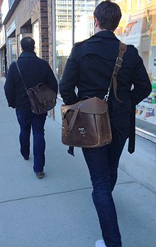 Men carrying satchels.