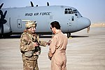 U.S. Air Force Col. Rhett Champagne speaks with the chief of staff of the Iraqi air force at Q-West Airfield.jpg