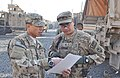 U.S. Army Sgt. 1st Class Christopher D.L. Perez, left, and Staff Sgt. Charles C. Chiguina, with the 1st Battalion, 294th Infantry Regiment, Guam Army National Guard, discuss the route to an airport in Kabul 131215-Z-WM549-002.jpg