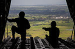 U.S. Marines look out the back of a KC-130J Hercules aircraft to observe a drop zone over Basa Air Base, Pampanga province, Philippines, during mass supply load training Oct. 2, 2013, during Amphibious Landing 131002-M-GX379-356.jpg