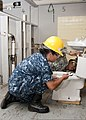 U.S. Navy Construction Apprentice Perla Arroyojaime, foreground, and U.S. Army Pfc. Jimmy Thompson, with the 366th Training Squadron, attach a toilet tank to the bowl of a bathroom at Sheppard Air Force Base 110725-F-NS900-014.jpg