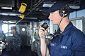 U.S. Navy Operations Specialist Seaman Jacob Ratcliffe, assigned to the guided missile destroyer USS Nitze (DDG 94), does a communications check while standing watch on the bridge in the Red Sea June 29, 2014 140629-N-AT101-002.jpg