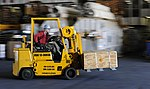 U.S. Navy Petty Officer 3rd Class Will Moseley drives a forklift through the hangar bay during weapons staging aboard the aircraft carrier USS John C. Stennis (CVN 74) as the ship operates in the Pacific Ocean on 130417-N-YW024-080.jpg