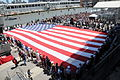 U.S. Service members and veterans hold a 100-foot U.S. flag that was unfurled during the Intrepid Sea, Air and Space Museum's Memorial Day ceremony in New York May 27, 2013 130527-N-NJ247-002.jpg