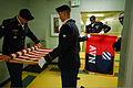 U.S. Soldiers with the 3rd Squadron, 17th Cavalry Regiment put away flags after they performed as the color guard detachment for the Boy Scouts of America, Tidelands District Awards Banquet at the Calvary 111201-A-XX166-005.jpg