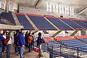 UConn's Gampel Pavilion in Mansfield with the UConn Huskies' Women's basketball team's NCAA championship banners visible.