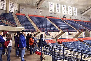 Connecticut Huskies - Gampel Pavilion: A prospective student tour group is shown the women's basketball championship banners.