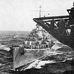 USS San Juan (CL-54) coming alongside USS Wasp (CV-7) in August 1942.jpg