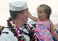 US Navy 030724-N-0879R-003 Yeoman 1st Class Michael Donkersloot is greeted by his two-year-old daughter upon his return to Pearl Harbor.jpg