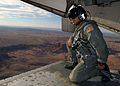 US Navy 031009-N-8629M-004 Aviation Structural Mechanic Airman Ismael Santiago-Gutierrez looks out over the Utah-Arizona border from the ramp of a C-2 Greyhound.jpg