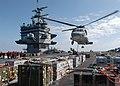 US Navy 040423-N-9742R-005 Aviation Ordnancemen attach a pallet of ordnance onto an HH-60H Seahawk.jpg