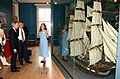 US Navy 040625-N-2568S-006 Curator for the USS Constitution Museum, Sarah Watkins, describes the Constitution's rigging to Secretary of the Navy, Gordon R. England and British Ambassador, Sir David Manning during a tour of the.jpg