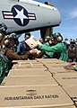 US Navy 050109-N-0057P-014 Sailors unload food supplies from a C-2A Greyhound.jpg