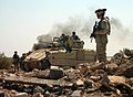 US Navy 050326-N-6501M-022 U.S. Army Soldiers assigned to the 2nd-11th Armored Cavalry Regiment (ACR) cautiously advance into a bunker area as they conduct a raid on the Hateen Weapons Complex in Babil, Iraq.jpg