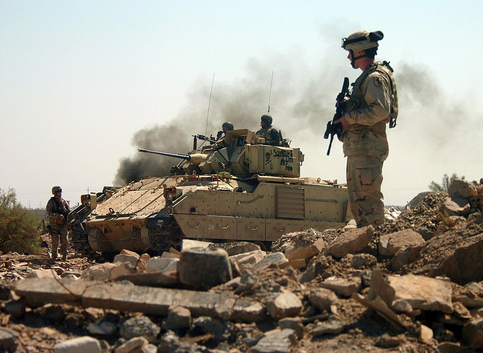 US Navy 050326-N-6501M-022 U.S. Army Soldiers assigned to the 2nd-11th Armored Cavalry Regiment (ACR) cautiously advance into a bunker area as they conduct a raid on the Hateen Weapons Complex in Babil, Iraq