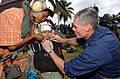 US Navy 050408-N-6665R-100 Lt. Cmdr. Robert Dobbins, one of two pharmacists stationed aboard the Military Sealift Command (MSC) hospital ship USNS Mercy (T-AH 19), secures the chinstrap of a cranial for an Indonesian boy.jpg