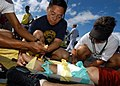 US Navy 050415-N-3019M-009 Sailors assigned to Naval Health Clinic, Makalapa treat and bandage Hospital Corpsman 3rd Class Sherwyne Santos during a mass casualty-decontamination drill on Pearl Harbor.jpg