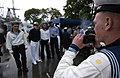 US Navy 050702-N-9851B-012 A Russian Navy Sailor takes a photograph of his friends with U.S. Sailors.jpg